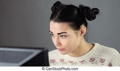 Confident young woman working at home - Cute serious girl...