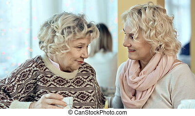 Confidential Relations - Close up of two women talking in...