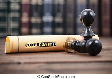 Confidential type of document and notary seals on the wooden background.
