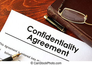 Confidentiality Agreement form on a table. Non-disclosure...