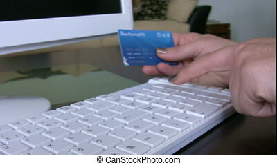 Confirming credit card data - Woman confirming credit card...