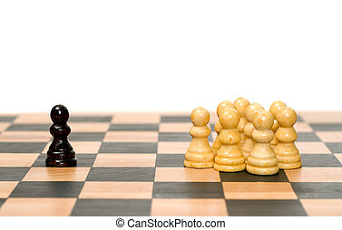 Conflict - A small group of white chess pawns separated from...