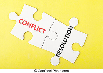 Conflict and resolution words printed on two pieces of...