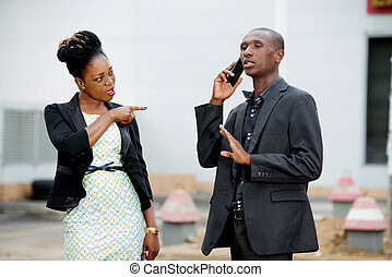 Conflict between a man and a businesswoman
