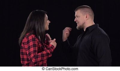 Conflict between couple, in which they push of each other. Slow motion