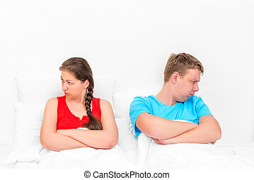 conflict situation of a young couple in bed