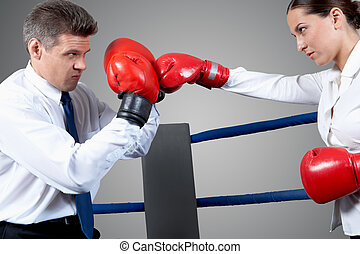 Conflict - Portrait of aggressive businessman in boxing...