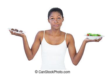 conflicted, vrouw, beslissen, om te eten, healthily, of,...