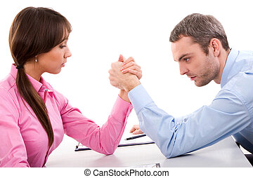 Confrontation - Man and woman in arm wrestling gesture on...