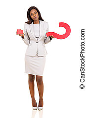 confused african american woman holding question mark