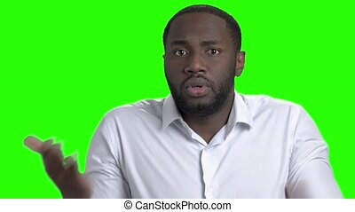 Confused afro-american guy on green screen. Thinking...