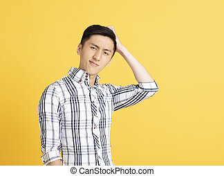confused asian young man thinking