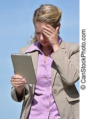 Confused Business Woman With Tablet