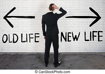 Confused Businessman Looking At Old And New Life On Wall
