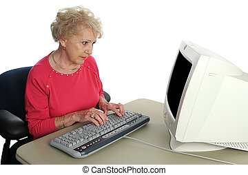 Confused by Computer - A senior lady confused by the ...
