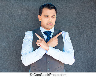 Confused guy pointing opposite fingers - Closeup portrait of...