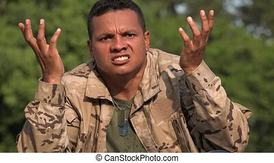 Confused Hispanic Male Soldier Wearing Camo