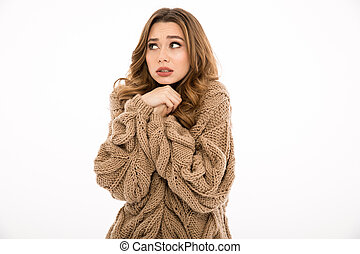 Confused lady dressed in warm sweater