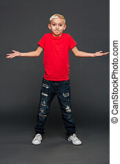 Confused little boy child standing isolated