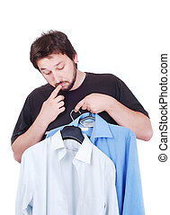 Confused male model between two shirts