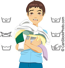 Confused young man having trouble doing laundry chores