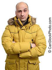 confused man wearing yellow winter jacket. Isolated on white