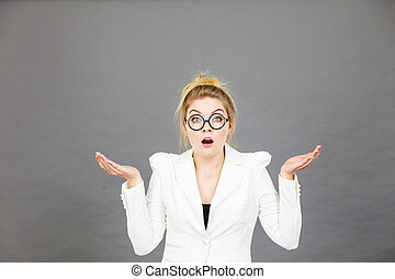 Confused office worker woman gesturing with hands