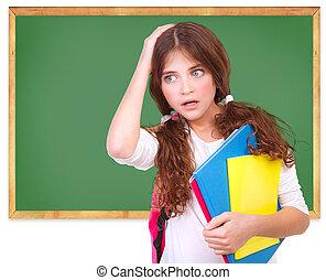 Confused school girl - Portrait of confused school girl...