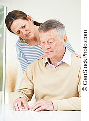 Confused Senior Man With Adult Daughter At Home