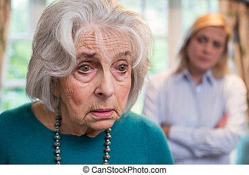 Confused Senior Woman With Adult Daughter At Home