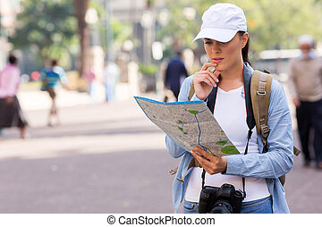 tourist on the street looking at a map
