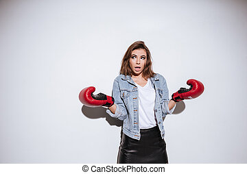 Confused woman boxer over white background