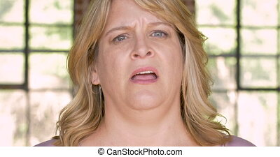 Confused woman expressing her uncertainty and rolling her eyes