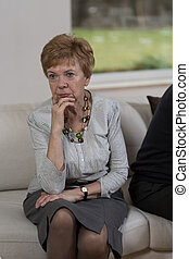Confused woman - Photo of senior confused woman after fight...