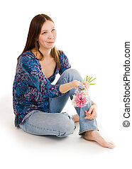 Confused woman siting on the flor with flowers in hand