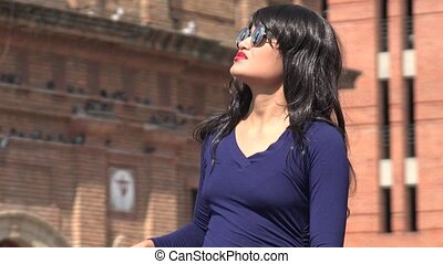 Confused Woman Wearing Sunglasses And Wig