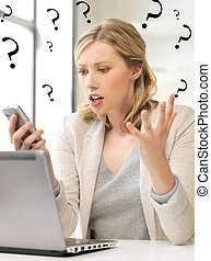 confused woman with cell phone - picture of confused woman...