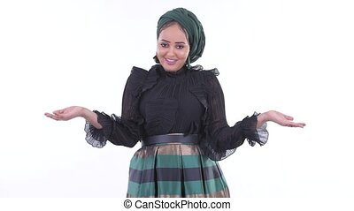 Confused young African Muslim woman shrugging shoulders -...