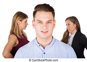 Confused young man with jealous women