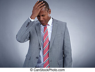 Photo of businessman touching his head on grey background