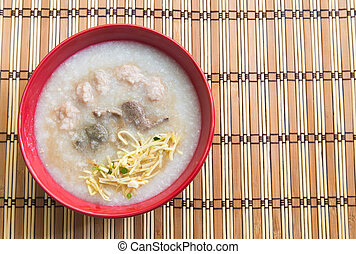 Congee, Rice porridge, Rice gruel, Rice soup on wooden background, Top view