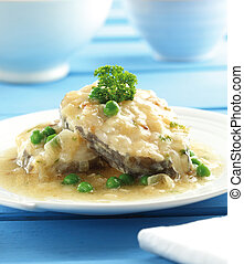 Conger with onion sauce - A plate of conger fish with onion ...