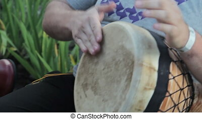 Congo drummer performing in nature