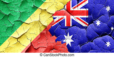 Congo flag with Australia flag on a grunge cracked wall