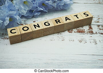 Congrats alphabet letter with space copy on wooden background