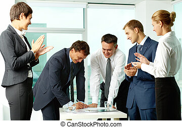 Congrats - Image of co-workers congratulating their...