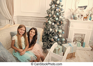 Congratulating her nearest. Happy new year. Winter. Christmas tree and presents. xmas online shopping. Family holiday. The morning before Xmas. Little girls. Child enjoy the holiday