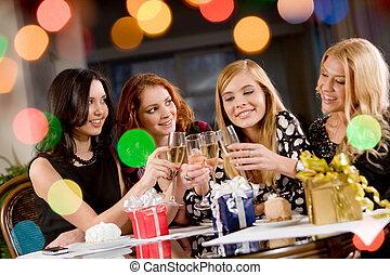 Congratulation - Portrait of attractive women clinking...