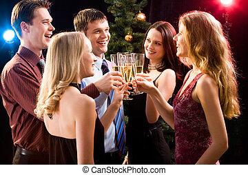 Congratulation - Portrait of several friends making a clink...