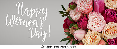 Congratulation text of Happy Women's Day over beautiful bright pink roses and tulips background